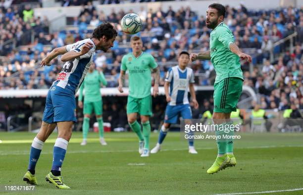 Esteban Granero of Espanyol heads the ball as Daniel Carvajal of Real Madrid attempts to block during the Liga match between Real Madrid CF and RCD...