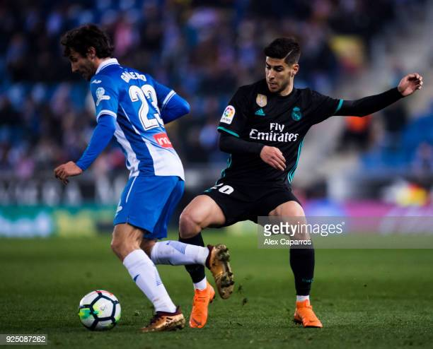 Esteban Granero of RCD Espanyol conducts the ball under pressure from Marco Asensio of Real Madrid CF during the La Liga match between Espanyol and...