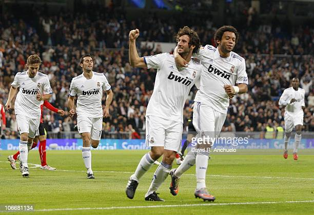 Esteban Granero of Real Madrid celebrates after scoring with his team mate Marcelo Vieira during the Copa del Rey match between Real Madrid and Real...