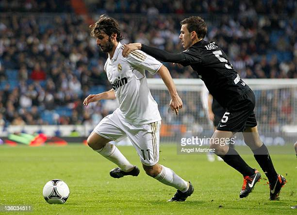 Esteban Granero of Real Madrid is chased by Isaias Sanchez of Ponferradina during the round of last 16 Copa del Rey second leg match between Real...