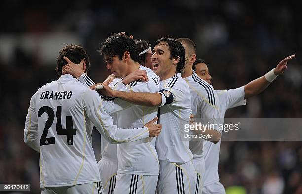 Esteban Granero of Real Madrid is congratulated by teammates Raul Gonzalez and Kaka after he set up Real's first goal during the La Liga match...