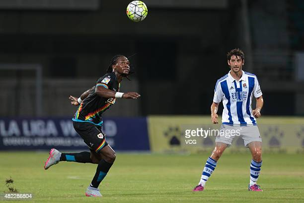 Esteban Granero of Real Sociedad and Manucho of Rayo Vallecano compete for the ball during a friendly match between Real Sociedad and Rayo Vallecano...