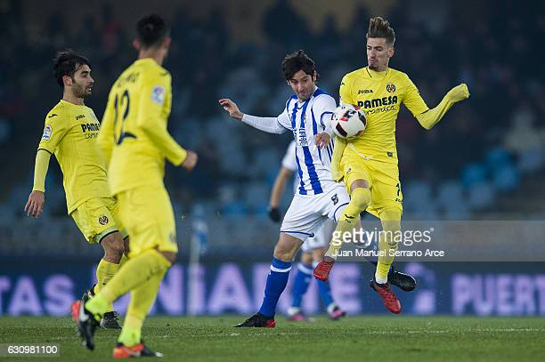 Esteban Granero of Real Sociedad duels for the ball with Samuel Castillejo of Villarreal CF during the Copa del Rey Round of 16 first leg match...