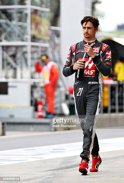 Esteban Gutierrez of Mexico and Haas F1 walks in the Pitlane during qualifying for the Formula One Grand Prix of Austria at Red Bull Ring on July 2...
