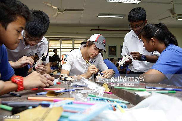 Esteban Gutierrez of Mexico and Sauber F1 joins local youth from the Chelsea FC Soccer School Singapore and Henderson Secondary School to build a...