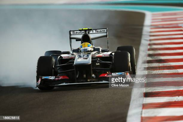 Esteban Gutierrez of Mexico and Sauber F1 locks his brakes while driving during qualifying for the Abu Dhabi Formula One Grand Prix at the Yas Marina...