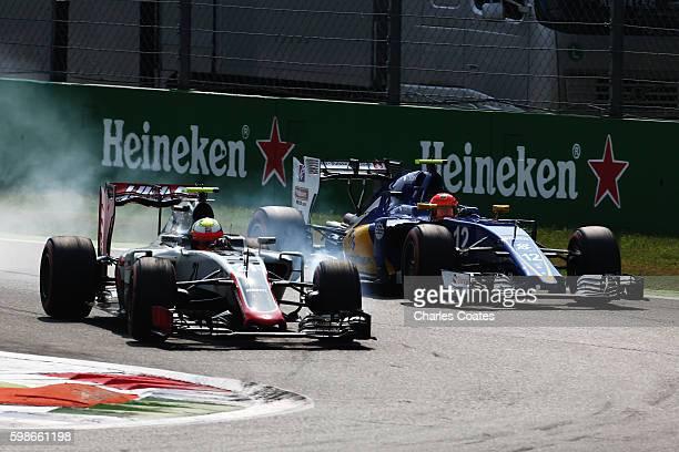 Esteban Gutierrez of Mexico driving the Haas F1 Team HaasFerrari VF16 Ferrari 059/5 turbo locks a wheel under braking next to Felipe Nasr of Brazil...