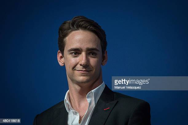 Esteban Gutierrez pilot of Formula 1 hears questions from fans and media during a conference as part of the FIA Motorex 2015 at Centro Banamex on...
