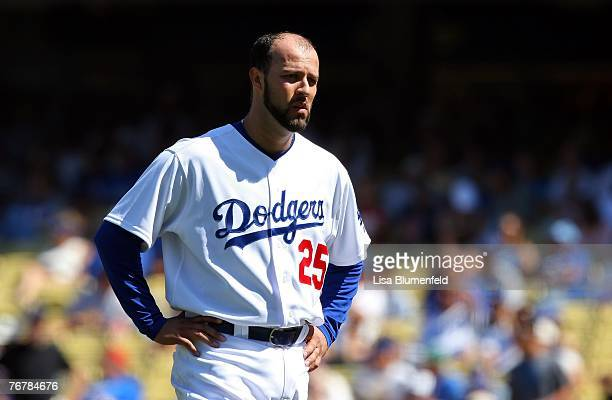 Esteban Loaiza of the Los Angeles Dodgers reacts after bunting into a double play to end the third inning against the Arizona Diamondbacks at Dodger...