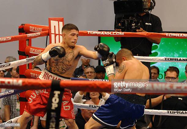 Esteban Nichol and Jonathan Alcantara sparr live in the boxing ring in the ESPN 3D section at the 2012 International Consumer Electronics Show at the...