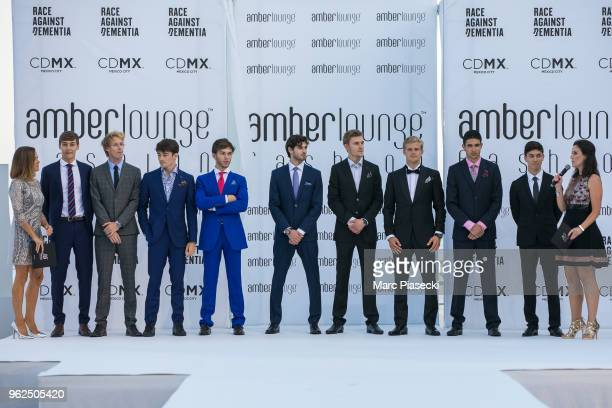 Esteban Ocon Marcus Ericsson Charles Leclerc Sergey Sirotkin Pierre Gasly Brendon Hartley George Russell and Antonio Giovinazzi pose on the runway...