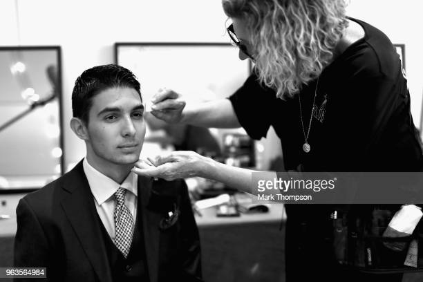 Esteban Ocon of France and Force India prepares backstage at the Amber Lounge Fashion show during previews ahead of the Monaco Formula One Grand Prix...
