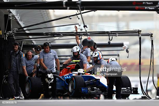 Esteban Ocon of France and Manor Racing gets pushed back into the garage during practice for the Abu Dhabi Formula One Grand Prix at Yas Marina...