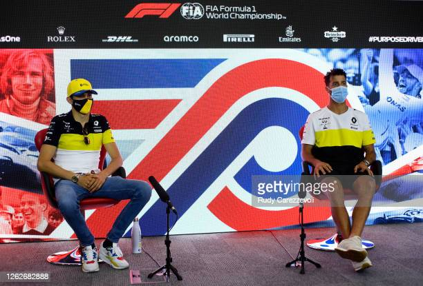 Esteban Ocon of France and Renault Sport F1 and Daniel Ricciardo of Australia and Renault Sport F1 talk in the Drivers Press Conference during...