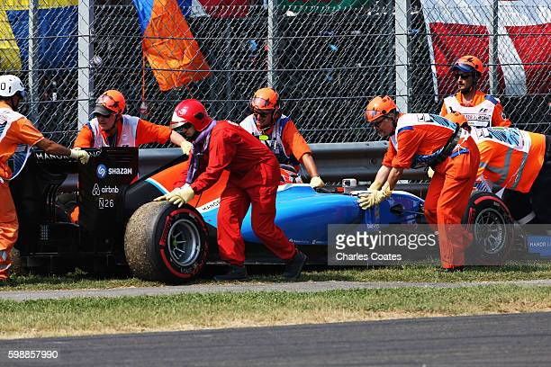Esteban Ocon of France driving the Manor Racing MRTMercedes MRT05 Mercedes PU106C Hybrid turbo gets removed from the circuit during qualifying for...