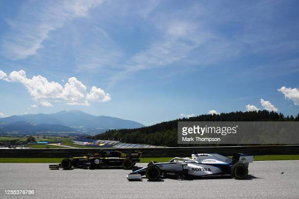 Esteban Ocon of France driving the Renault Sport Formula One Team RS20 and Jack Aitken of Great Britain driving the Williams Racing FW43 Mercedes on...