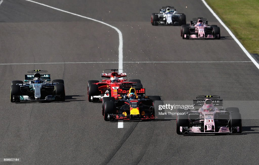 Esteban Ocon of France driving the (31) Sahara Force India F1 Team VJM10, Daniel Ricciardo of Australia driving the (3) Red Bull Racing Red Bull-TAG Heuer RB13 TAG Heuer, Sebastian Vettel of Germany driving the (5) Scuderia Ferrari SF70H and Valtteri Bottas driving the (77) Mercedes AMG Petronas F1 Team Mercedes F1 WO8 battle for position during the Formula One Grand Prix of Japan at Suzuka Circuit on October 8, 2017 in Suzuka.