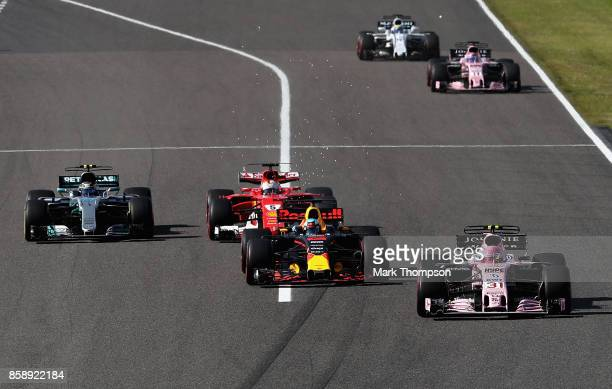 Esteban Ocon of France driving the Sahara Force India F1 Team VJM10 Daniel Ricciardo of Australia driving the Red Bull Racing Red BullTAG Heuer RB13...