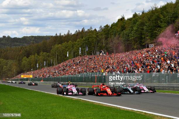 Esteban Ocon of France driving the Sahara Force India F1 Team VJM11 Mercedes Sebastian Vettel of Germany driving the Scuderia Ferrari SF71H Lewis...