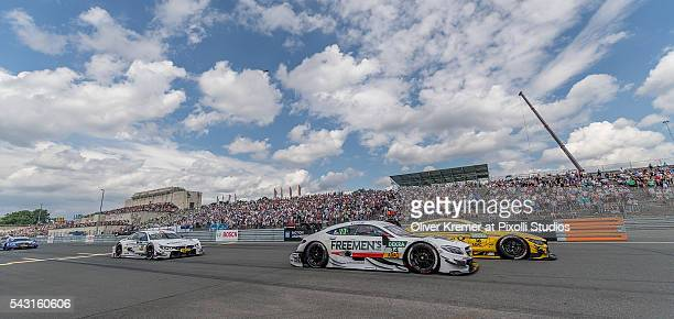 Esteban Ocon of MercedesAMG DTM Team Art and Timo Klock of BMW Team RMG head to head racing for the German Touring Car Championship at the Norisring...