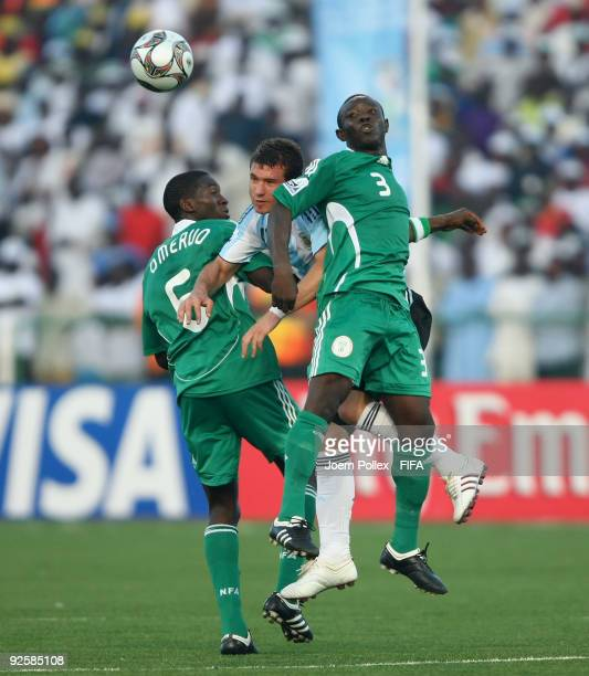 Esteban Orfano of Argentina and Kenneth Omeru and Mohammed Aliyu of Nigeria battle for the ball during the FIFA U17 World Cup Group A match between...