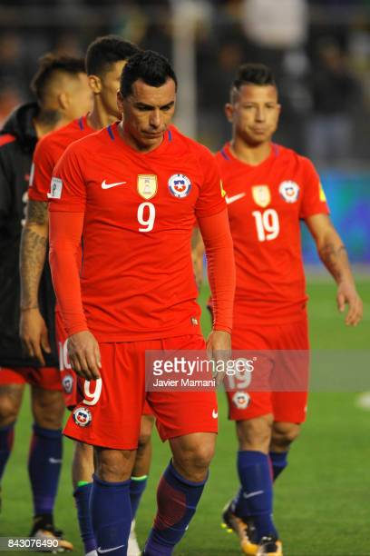 Esteban Paredes and Leonardo Valencia of Chile look dejected after losing a match between Bolivia and Chile as part of FIFA 2018 World Cup Qualifiers...