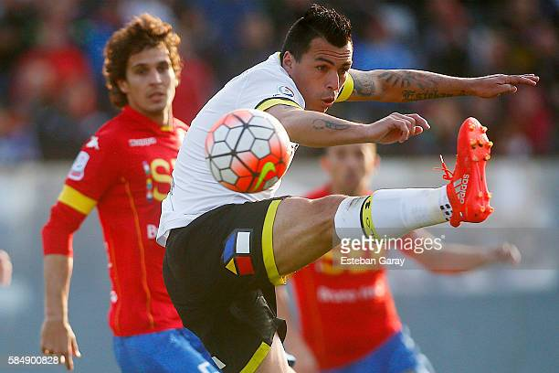 Esteban Paredes jumps for the ball during a match between Colo Colo and Union Espanola as part of Campeonato Apertura 2016 at Monumental David...