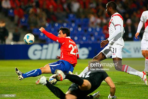 Esteban Paredes of Chile battles for the ball against Christian Ramos of Peru during a match as part of group C of 2011 Copa America at Malvinas...