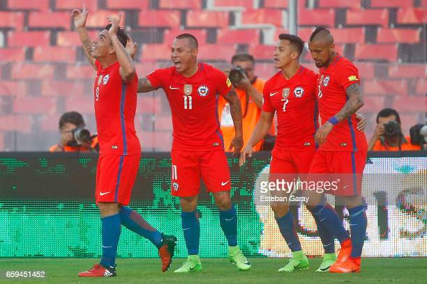 Esteban Paredes of Chile celebrates with Eduardo Vargas Alexis Sanchez and Arturo Vidal after scoring the third goal of his team during a match...