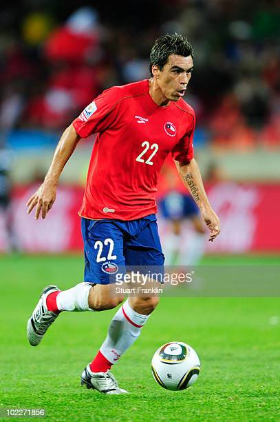 Esteban Paredes of Chile runs with the ball during the 2010 FIFA World Cup South Africa Group H match between Chile and Switzerland at Nelson Mandela...
