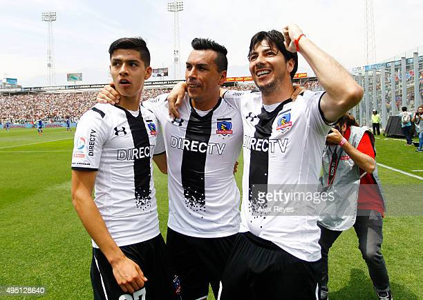 Esteban Paredes of Colo Colo celebrates with teammates after scoring the second goal of his team during a match between Colo Colo and U de Chile as...