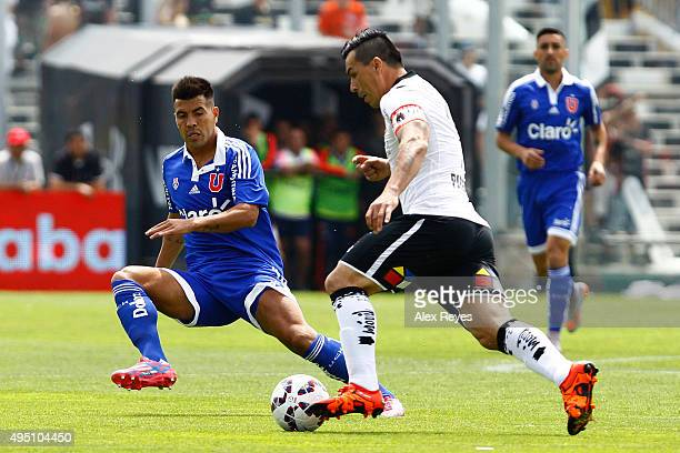 Esteban Paredes of Colo Colo fights for the ball with Gonzalo Espinoza of U de Chile during a match between Colo Colo and U de Chile as part of...