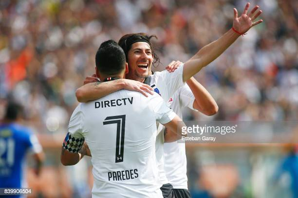 Esteban Paredes of ColoColo celebrates with teammate Jaime Valdes after scoring the third goal of his team during a match between ColoColo and U de...