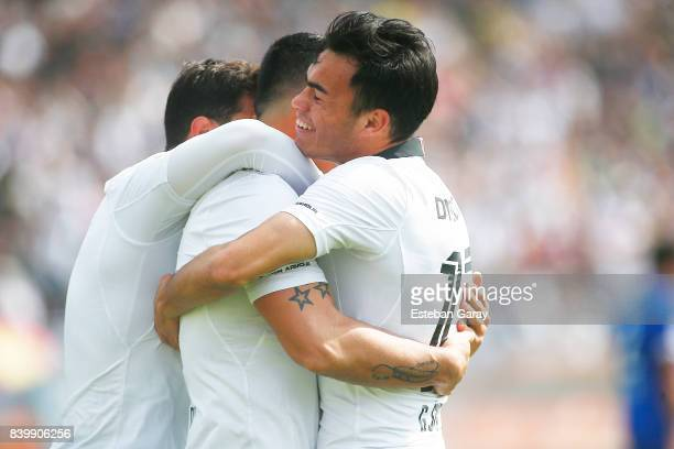 Esteban Paredes of ColoColo celebrates with teammates after scoring the third goal of his team during a match between ColoColo and U de Chile as part...