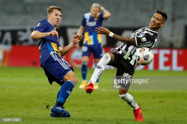 Esteban Rolón of Boca Juniors fights for the ball with Matias Zaracho of Atletico MG during a round of sixteen second leg match between Atletico...