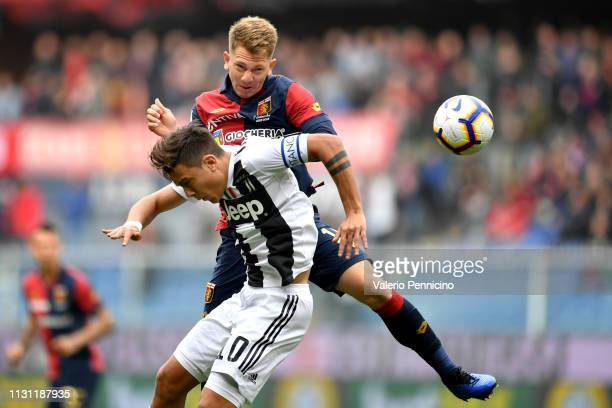Esteban Rolon of Genoa CFC clashes with Paulo Dybala of Juventus during the Serie A match between Genoa CFC and Juventus at Stadio Luigi Ferraris on...