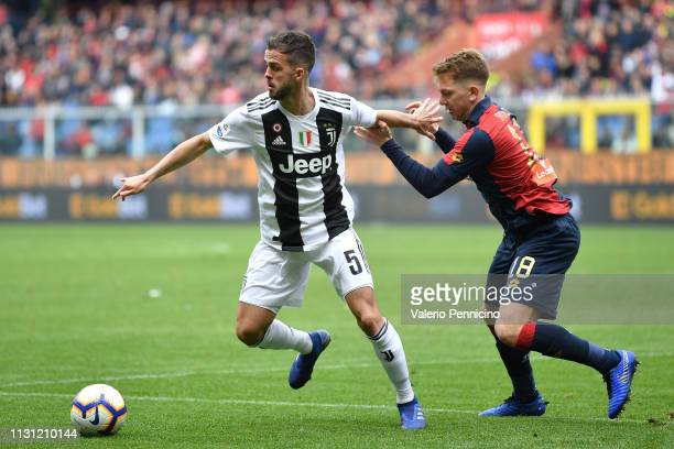 Esteban Rolon of Genoa CFC competes with Miralem Pjanic of Juventus during the Serie A match between Genoa CFC and Juventus at Stadio Luigi Ferraris...