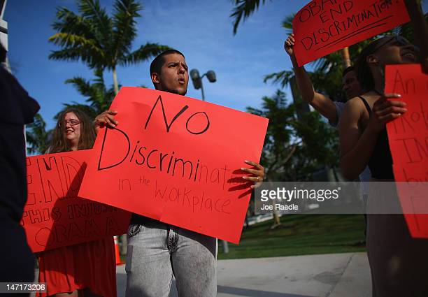 Esteban Roncancio along with other protesters of the lesbian gay bisexual and transgender Americans make their views known as they stand outside a...