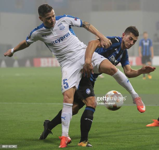 Esteban Sachetti of Apollon Limassol FC competes for the ball with Remo Freuler of Atalanta BC during the UEFA Europa League group E match between...