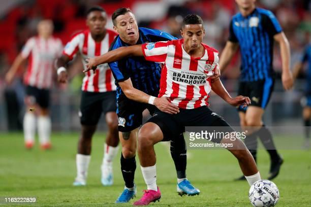 Esteban Sachetti of Apollon Limassol Mohammed Ihattaren of PSV during the UEFA Europa League match between PSV v Apollon Limassol at the Philips...