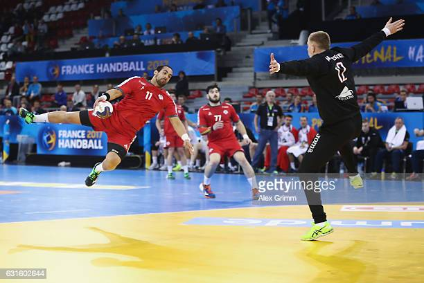 Esteban Salinas of Chile scores a goal against goalkeeper Ivan Matskevich of Belarus during the 25th IHF Men's World Championship 2017 match between...