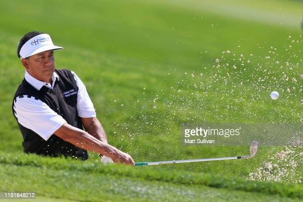 Esteban Toledo of Mexico hits from a bunker on the 13th hole during the third round of the KitchenAid Senior PGA Championship at Oak Hill Country...