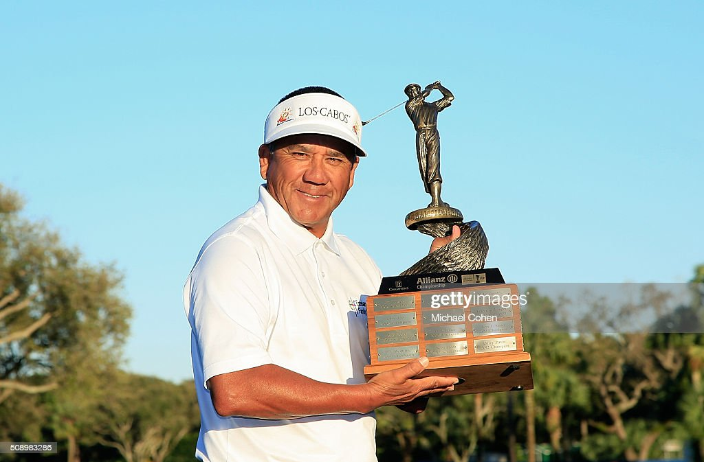 Esteban Toledo of Mexico holds the trophy after winning a three hole sudden death playoff at the Allianz Championship held at The Old Course at Broken Sound on February 7, 2016 in Boca Raton, Florida.
