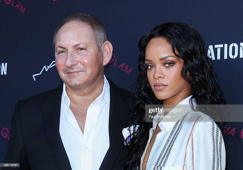 Estee Lauder Executive John Demsey (L) and Recording Artist Rihanna (R) attend the Roc Nation pre-Grammy brunch on January 25, 2014 in Los Angeles, California.