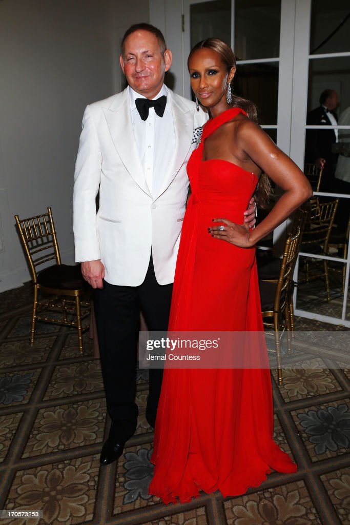 Estee Lauder group President John Dempsey and Iman pose during the 4th Annual amfAR Inspiration Gala New York at The Plaza Hotel on June 13, 2013 in New York City.