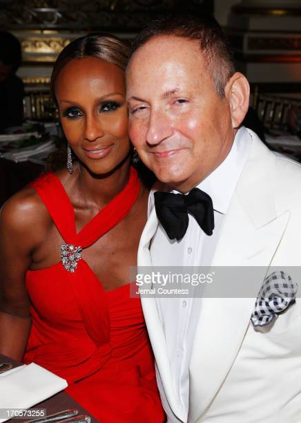 Estee Lauder group President John Dempsey and Iman pose during the 4th Annual amfAR Inspiration Gala New York at The Plaza Hotel on June 13 2013 in...