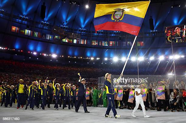Estefania Garcia of Ecuador carries the flag during the Opening Ceremony of the Rio 2016 Olympic Games at Maracana Stadium on August 5 2016 in Rio de...