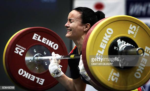 Estefania Juan of Spain competes in the women's 53 kg during the European Weightlifting Championship in Sofia 19 April 2005 Nastassia Novikava of...