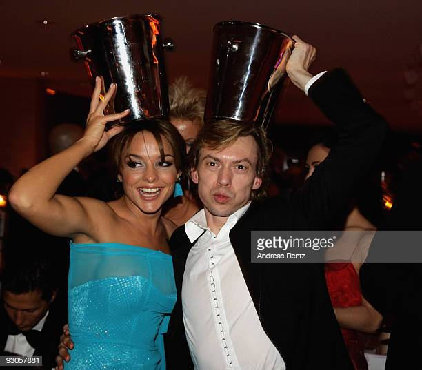 Estefania Kuester and ballet dancer Vladimir Malakhov joke with champagne coolers during the Unesco Charity Gala 2009 at the Maritim Hotel on...