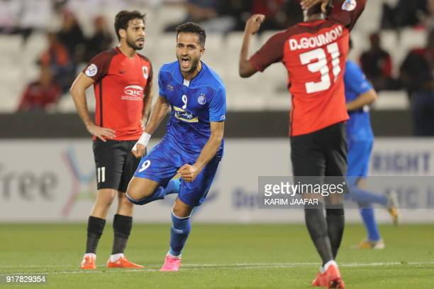 Esteghlal FC's Iranian forward Ali Ghorbani celebrates after scoring a goal against AlRayyan SC during their Asian Champions League football match at...